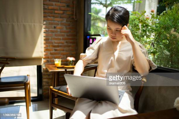 asian female freelancer concentrate working with laptop computer  with copyspace - concentration camp stock pictures, royalty-free photos & images