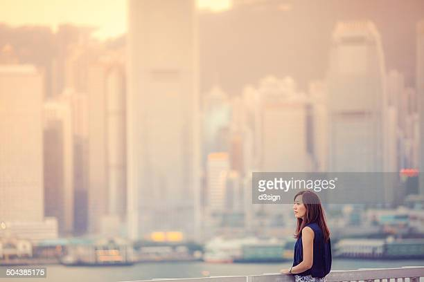 Asian female is enjoying the Hong Kong cityscape