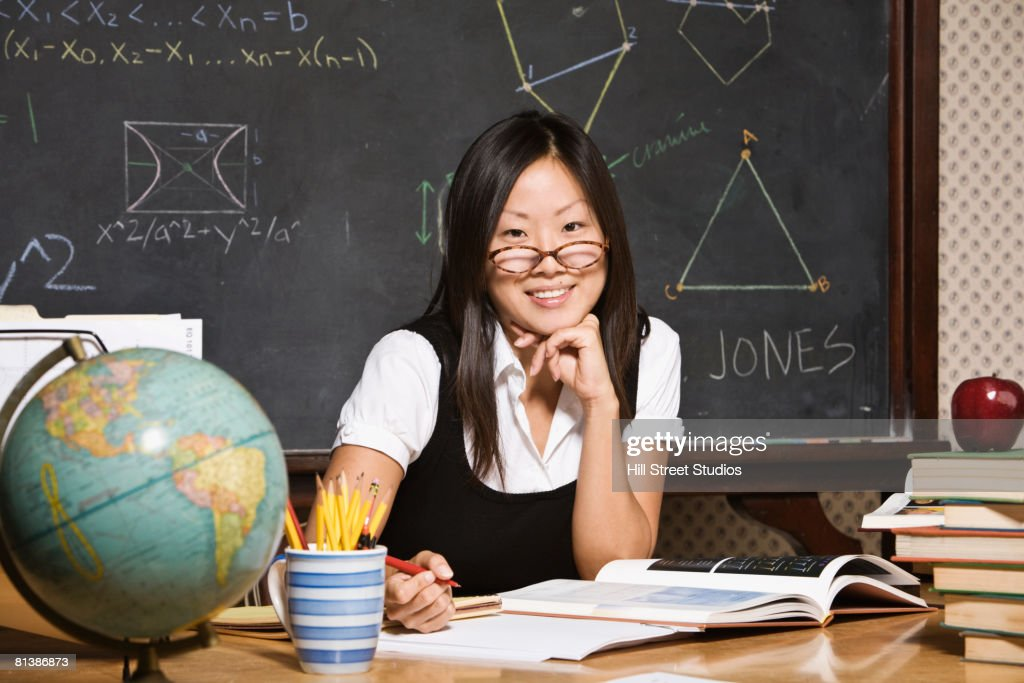 Asian Female Math Teacher At Desk Stock Photo  Getty Images-8120