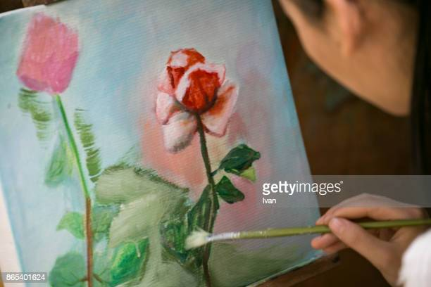 Asian Female painter drawing in the flower