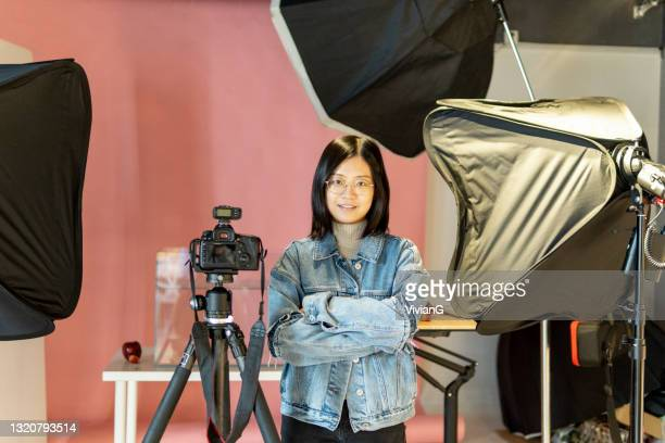 asian female photographer in the studio - photographer stock pictures, royalty-free photos & images
