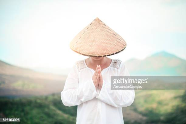 Asian Female Praying Near the Volcano Mountain