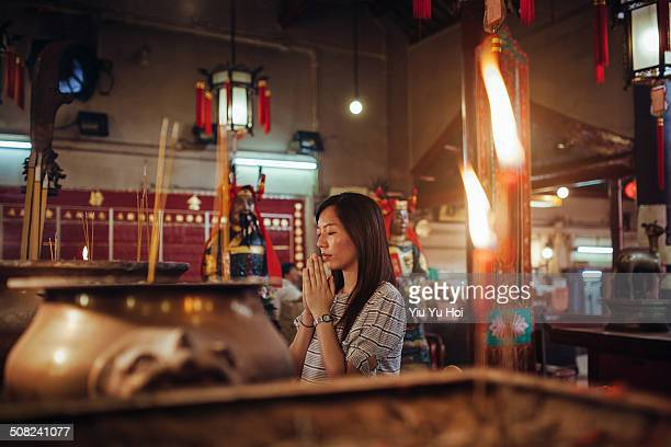 asian female praying sincerely in a chinese temple - sincerely yours ストックフォトと画像