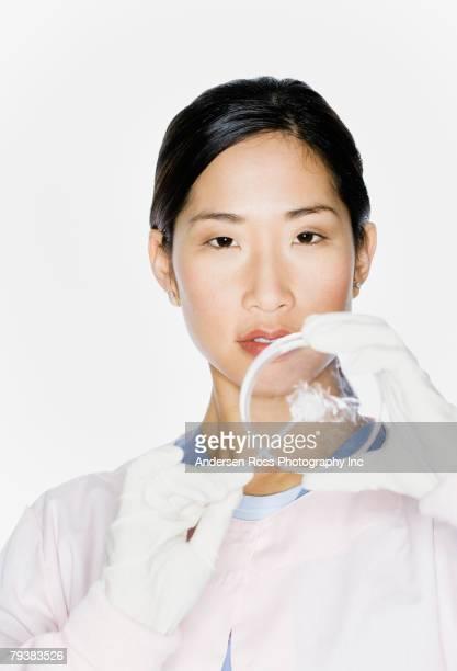 Asian female scientist holding Petri dish