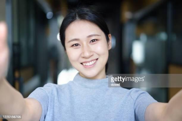 asian female selfie in office - selfie stock pictures, royalty-free photos & images