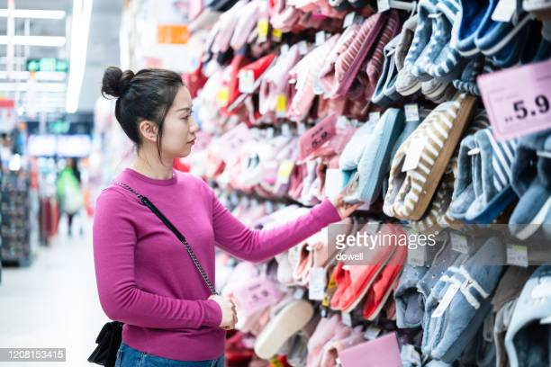 asian female shopping in supermarket - slipper stock pictures, royalty-free photos & images