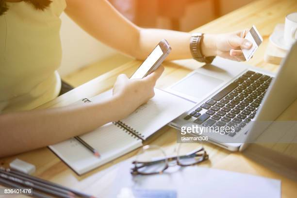 asian female startup business. strategy planning meeting. and online business marketing with laptop computer and credit card - online banking stock pictures, royalty-free photos & images