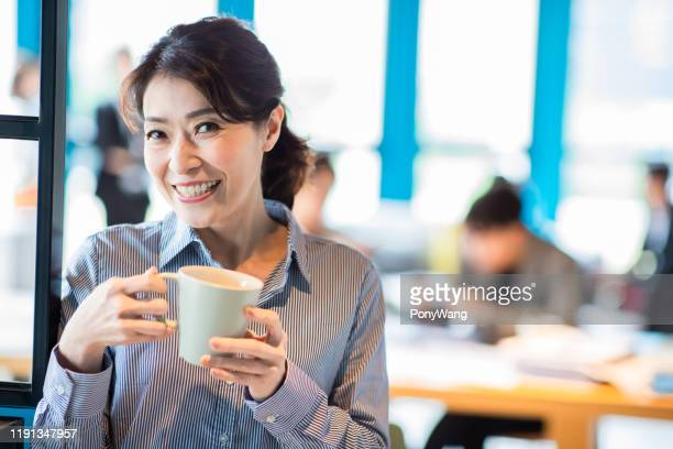 asian female supervisor smile - korean ethnicity stock pictures, royalty-free photos & images