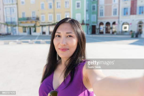 asian female traveler taking selfie - hot women pics stock pictures, royalty-free photos & images