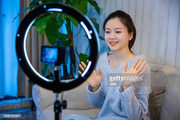 asian female vlogger - live broadcast stock pictures, royalty-free photos & images