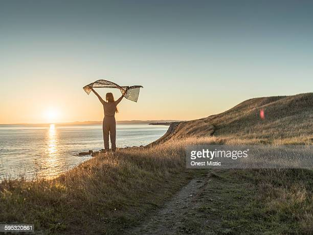 asian female walking at cliff - shawl stock pictures, royalty-free photos & images