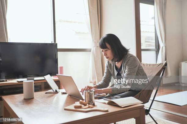 asian female worker working from home. - 女性 ストックフォトと画像