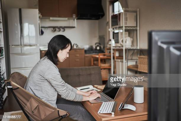 asian female worker working from home. - only japanese stock pictures, royalty-free photos & images