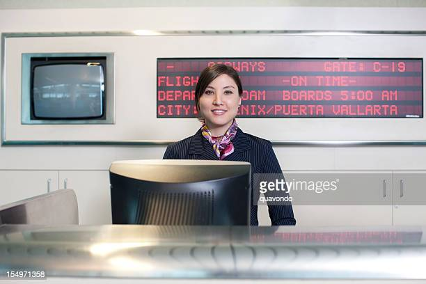 Asian Flight Attendant at Airport Ticket Counter, Copy Space