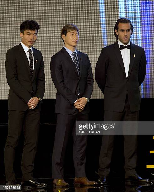 Asian Football Confederation Player of the Year nominees Lee Keun Ho of South Korea Zheng Zhi of China and Mohammad Ali Karimi from Iran wait for the...