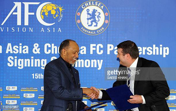 Asian Football Confederation president Mohammed bin Hammam shakes hands with Chelsea FC chief executive Ron Gourlay following a signing ceremony of...