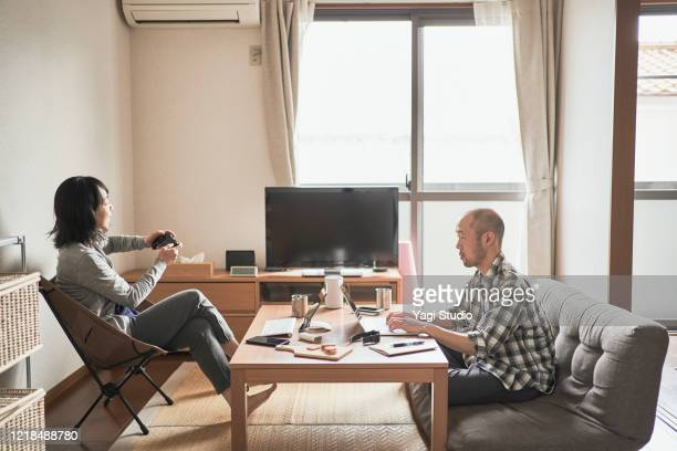 Asian freelance couple working together at home