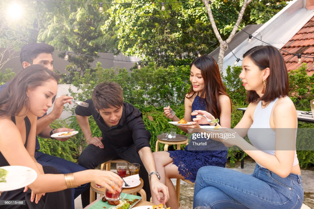 Asian Friends Enjoying Outdoor Roof Top Party : Stock Photo
