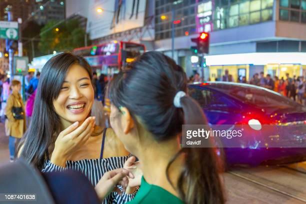 asian friends having fun together at night in hong kong - fashion hong kong stock photos and pictures