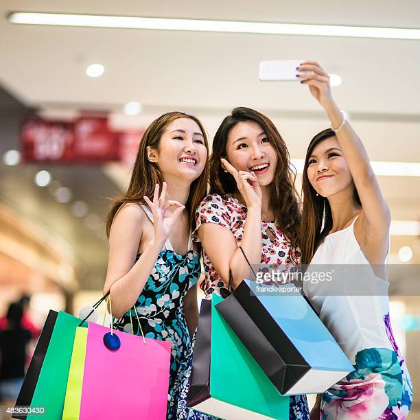 Asian friends shopping in the mall and take a selfie