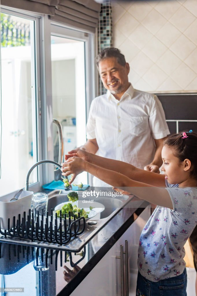Asian Girl and Grandfather Preparing Vegetables for Thai Food : Stock Photo