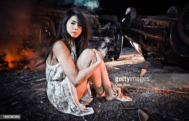 Asian girl by car accident