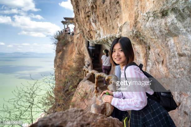 asian girl climbing the mountain - kunming stock pictures, royalty-free photos & images