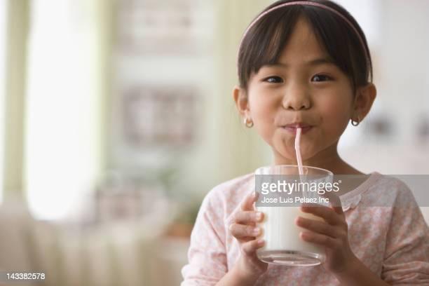 Asian girl drinking milk