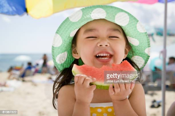 asian girl eating watermelon at beach - watermelon stock pictures, royalty-free photos & images