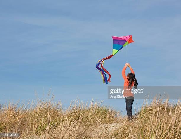 アジアの女の子を飛ぶカイトビーチ