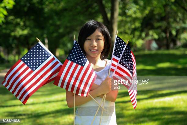 Asian Girl Holding American Flags