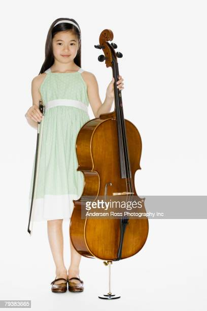 Asian girl holding cello