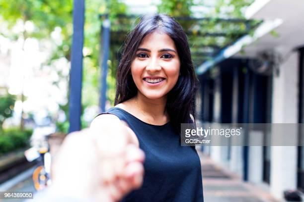 Asian girl holding hand and saying goodbye