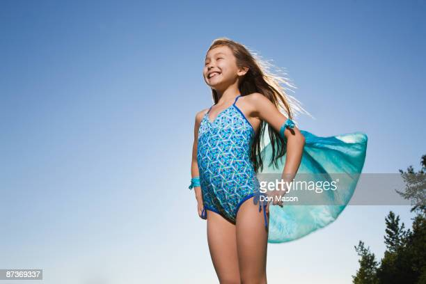 Asian girl in bathing suit with scarf