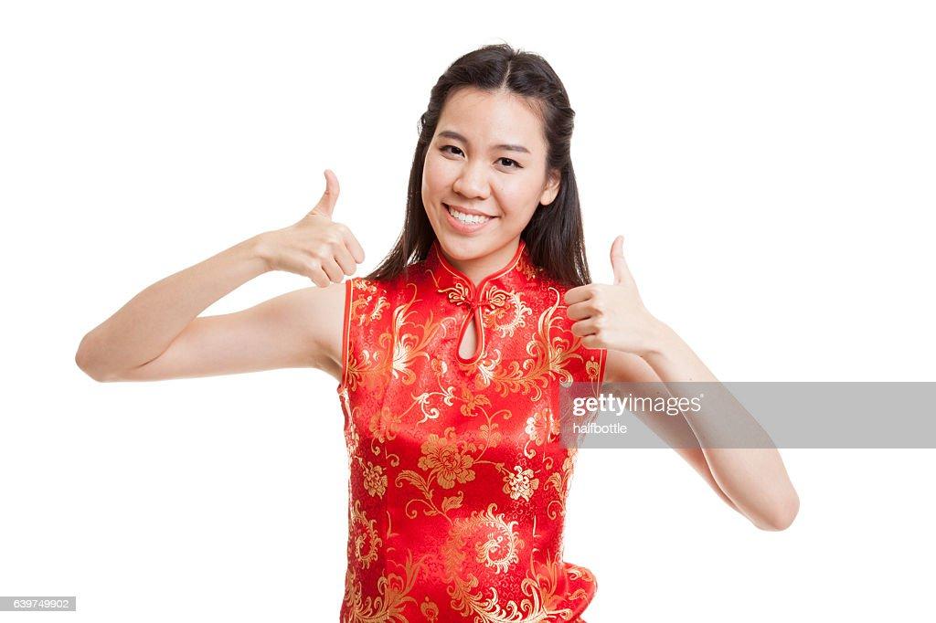 Asian girl in chinese cheongsam dress thumbs up. : Stock Photo