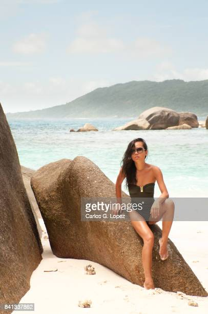 asian girl in green swimming suit and sunglasses posing on rock - hot indian model stock pictures, royalty-free photos & images