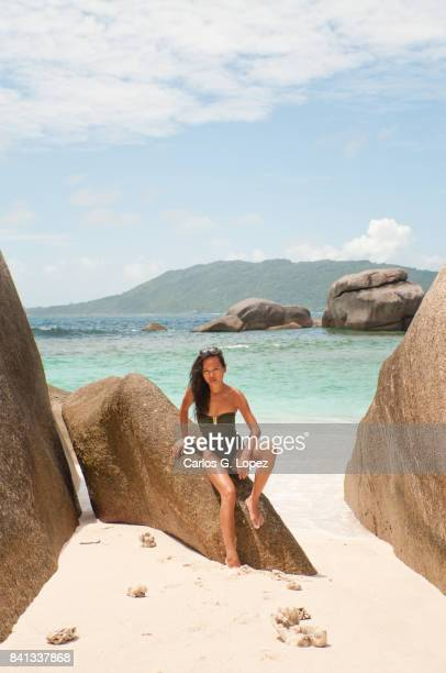 asian girl in green swimming suit posing on rock - hot indian model stock pictures, royalty-free photos & images