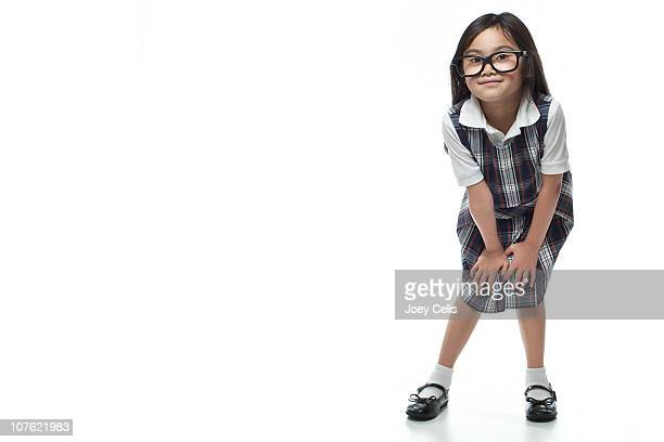 Asian girl in private school uniform and glasses