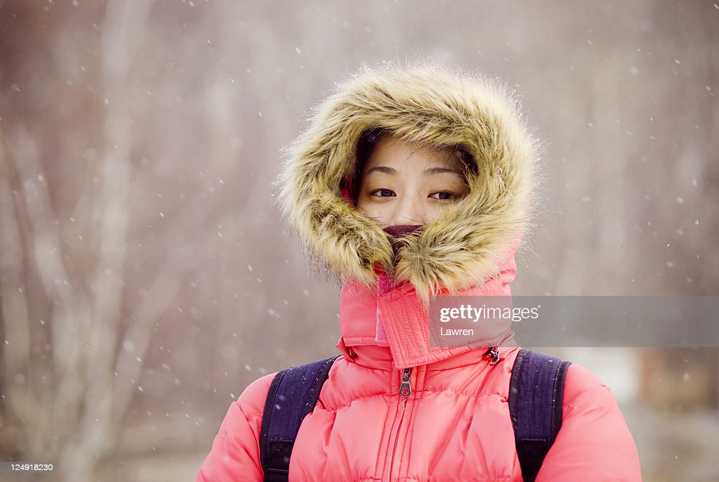 Asian girl in snowing day : Stock Photo