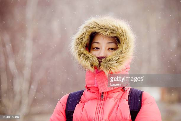asian girl in snowing day - parka coat stock photos and pictures
