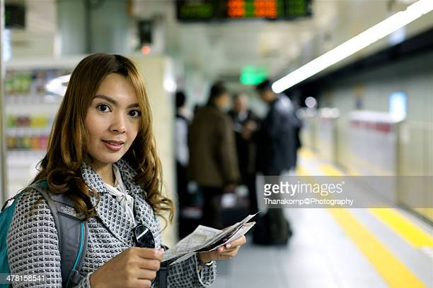 Asian girl is checking map for subway