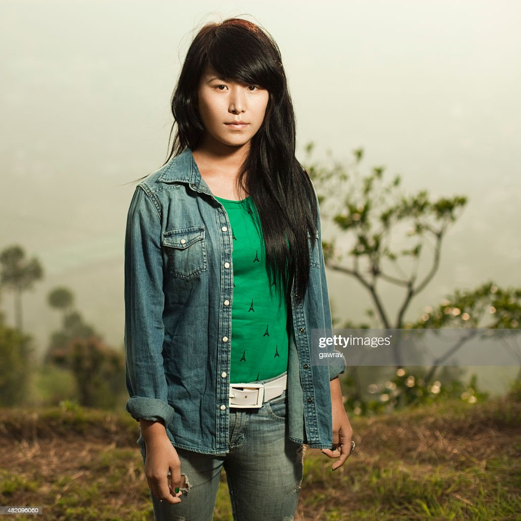 Late Teen Indian Girl Looking At Camera With Blank Expression ...