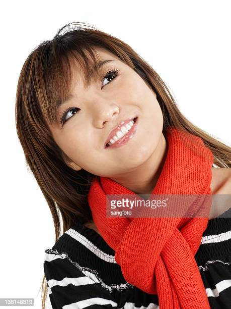 Asian girl looking up in winter clothes