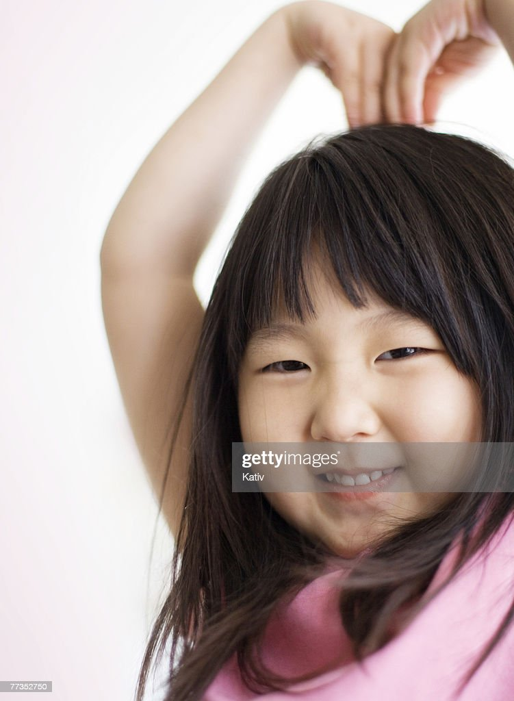 Asian girl making big heart shape with her hand. : Photo