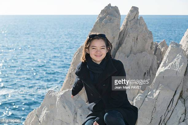 Asian girl on the rocks