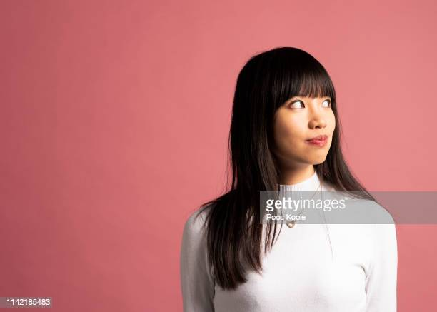 asian girl - studio shot stock pictures, royalty-free photos & images