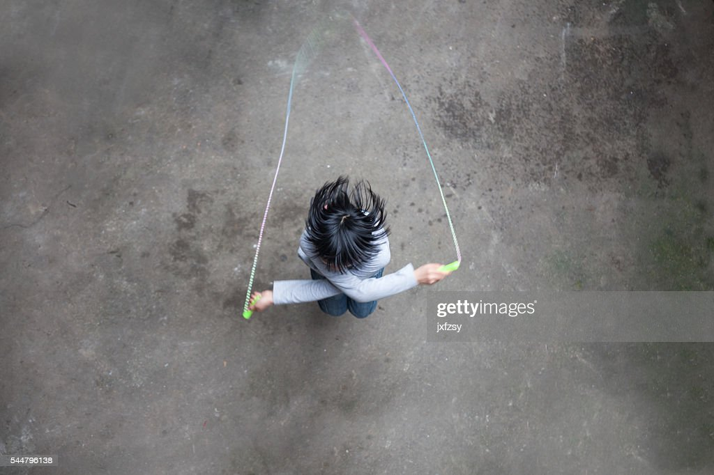 asian girl playing rope skipping : Stock Photo