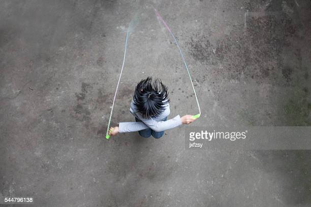 asian girl playing rope skipping - skipping along stock photos and pictures