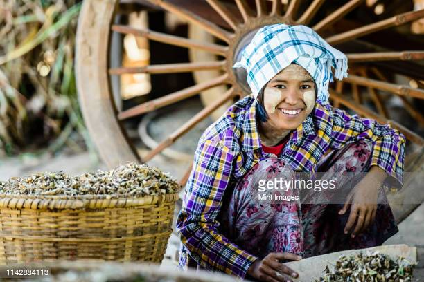 asian girl selling herbs in market - tradition stock pictures, royalty-free photos & images