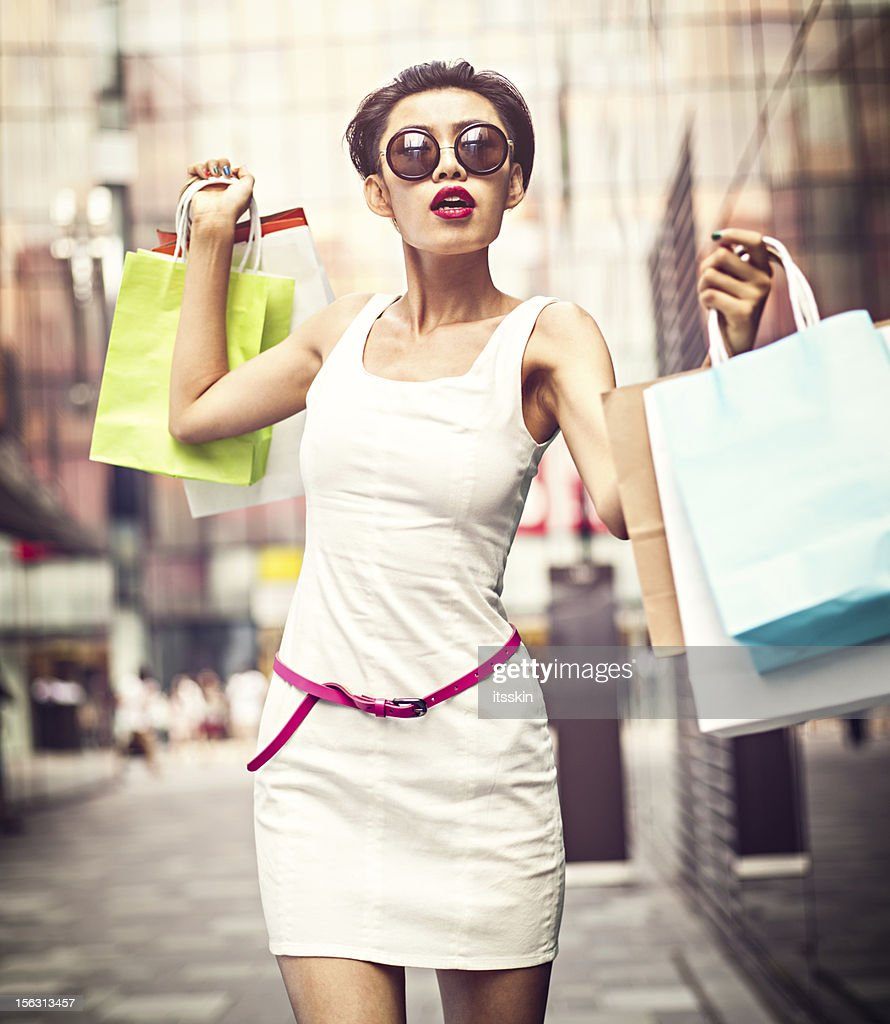 Asian girl shopping : Stock Photo